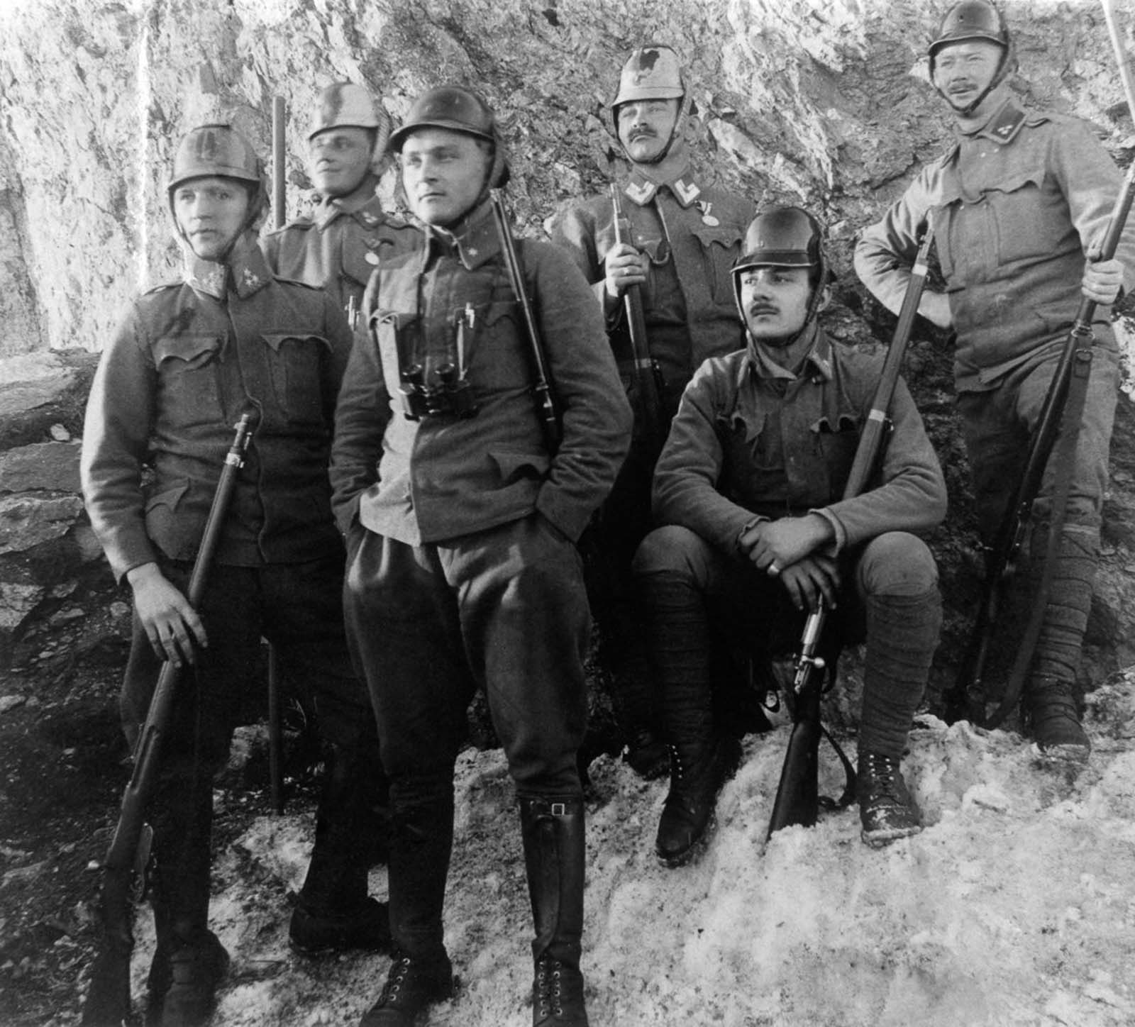 Austro-Hungarian soldiers wear new steel helmets.