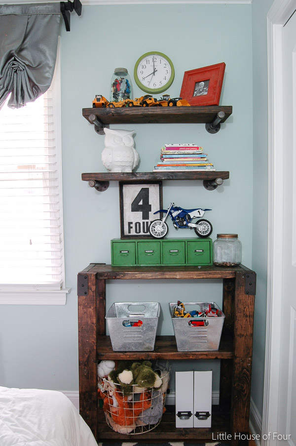 Boy room decor with DIY wall shelves and storage unit