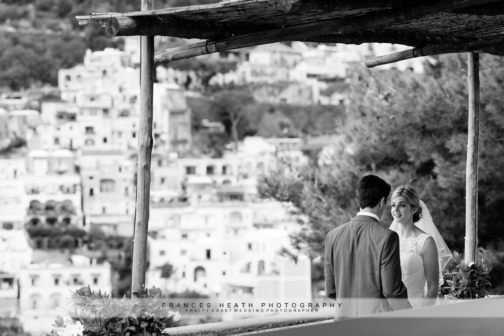 Bride and groom with view of Positano