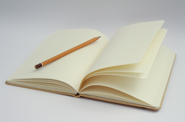 A blank notebook with a pencil - MSS Articles