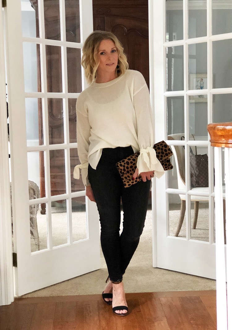 bell sleeve sweater with black skinny jeans and leopard sandals