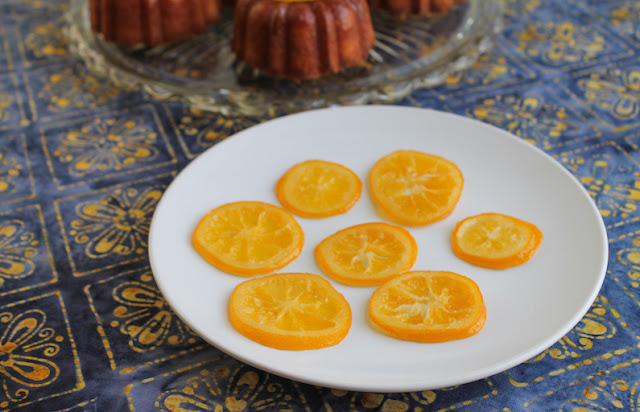 Food Lust People Love: Candied lemon slices are beautiful perched atop a cake but we have been known to eat them as is. They are a lovely combination of tart and sweet and they are wonderfully sticky.