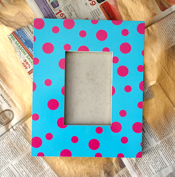 blue picture frame with pink dots