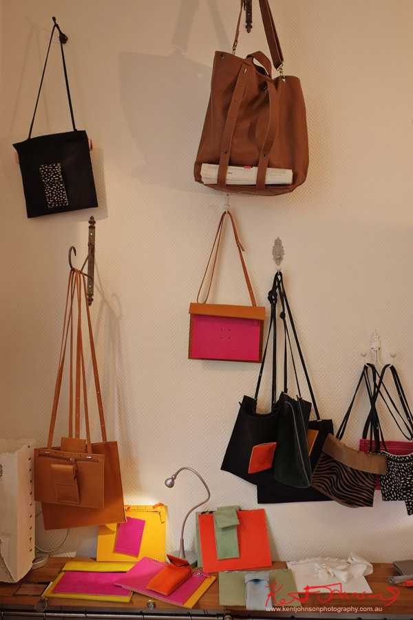 A selection of bags hanging from they studio wall. Photography by Kent Johnson for Street Fashion Sydney - Paris Edition.
