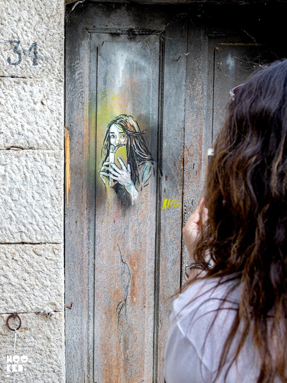 Italian Street Artist Alice Pasquini stencil work in Civita Campomarano