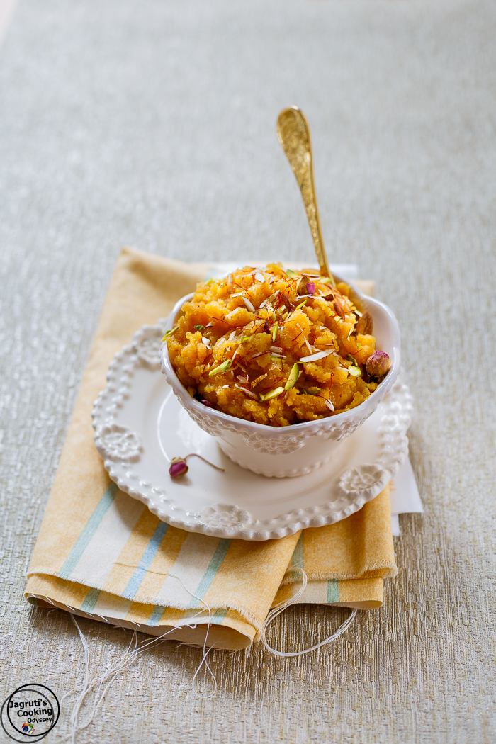 Badam Besan Ka Halwa is a rich and delicious Indian Sweet, which is perfect for any celebrations or occasions. It is prepared with ground almonds, chick pea flour, khoya, sugar and milk and garnished with rich nuts, saffron and edible gold leaf. It's a real soul satisfying treat!