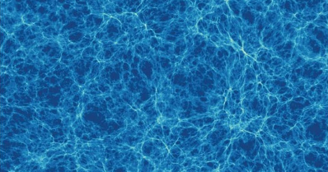 This is a simulation showing a section of the Universe at its broadest scale. A web of cosmic filaments forms a lattice of matter, enclosing vast voids. Credit: Tiamat simulation, Greg Poole