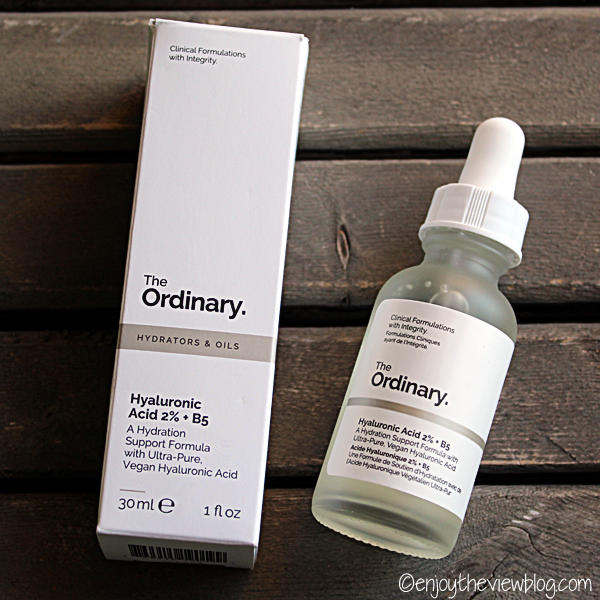 A bottle of Hyaluronic Acid 2% + B5 from the Ordinary lying on a table with the box beside it