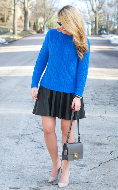 blue sweater and black skirt with grey pumps and ferragamo bag
