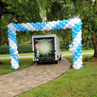 Drive-by big balloon arch for baby shower party decoration. It's a Boy baby shower decoration. Huge balloon arch, blue and white balloon arch, party balloon arch design.