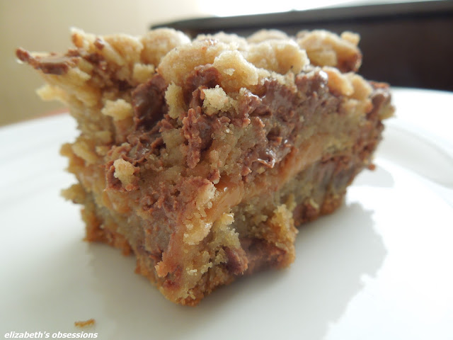 close up of a caramel stuffed chocolate chip cookie bar on a white plate