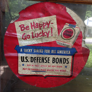 Be Happy Go Lucky cigarette ad and reminder to buy bonds.