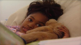 A girl prepares to go to sleep. Sesame Street Bedtime with Elmo