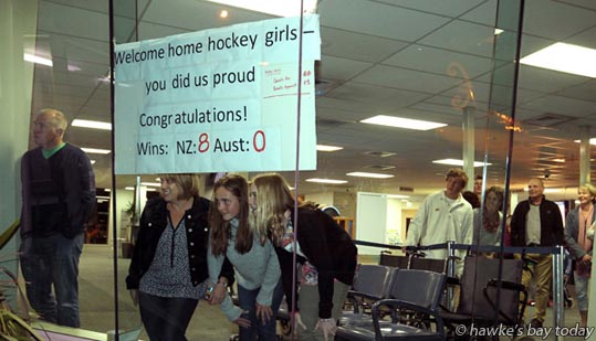 L-R: Andrew Norris, Sophia Roydhouse-Ross, Jess Norris, Amber Roydhouse-Ross were amongst family and friends at the Hawke's Bay Airport, Napier, welcoming home the undefeated Hawke's Bay under-15 girls' hockey invitational Australian tour team who are back from a 12-day competition in Brisbane, Gold Coast and Sydney. photograph