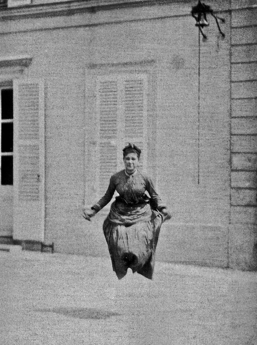 Vintage photo. An Edwardian woman jump ropes in the courtyard. Deadly Dullness, A Word to Women by Mrs. C. E. Humphry, 1898. marchmatron.com