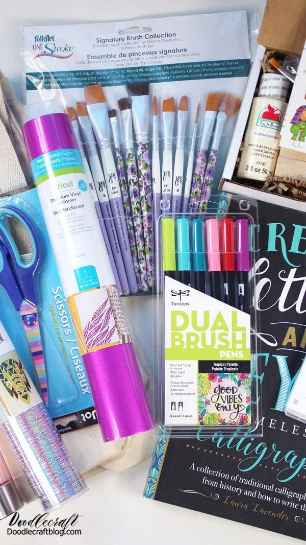 You'll get a bunch of fun supplies that you can craft and create for handmade gifts!  Winner will receive: Nativity Block Kit Paintbrushes Tombow Dual Brush Pens 6 Pack Stampin Up Greetings of the Season Creative Lettering Book Permanent Vinyl in fucsia and holographic threads Water Bottle (that needs customizing) Tote Bag Blank Decorative Scissors!