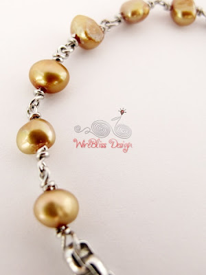 Close up of Wire Wrapped Minima Bracelet (Minlet) with Gold pearl
