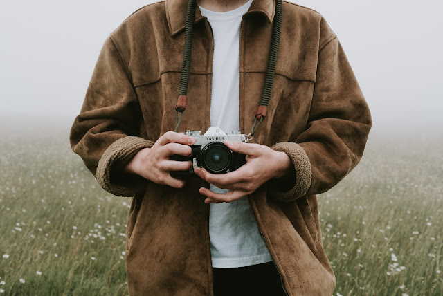 A person holding his camera.