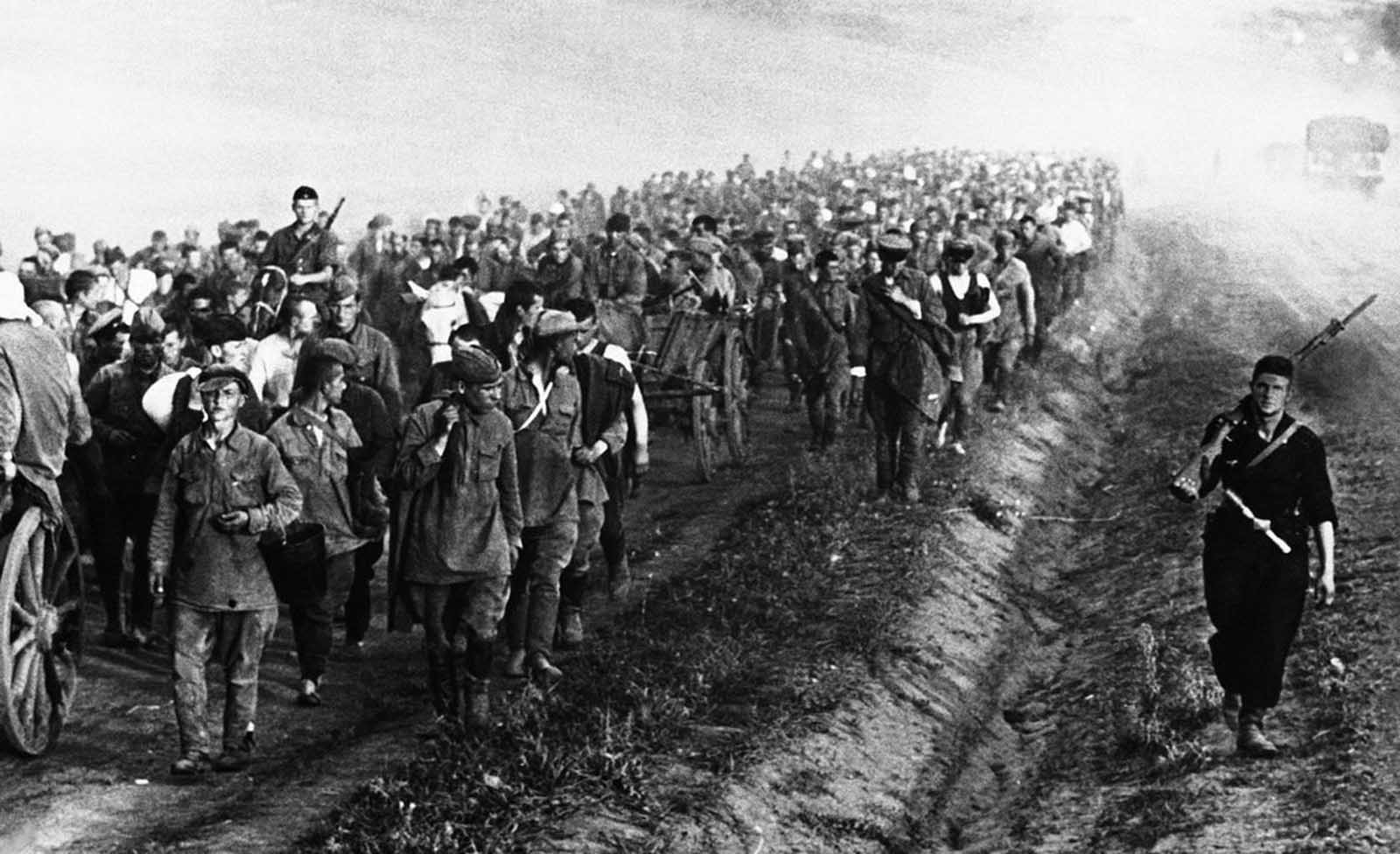 An column of Russian prisoners of war taken during recent fighting in Ukraine, on their way to a Nazi prison camp on September 3, 1941.