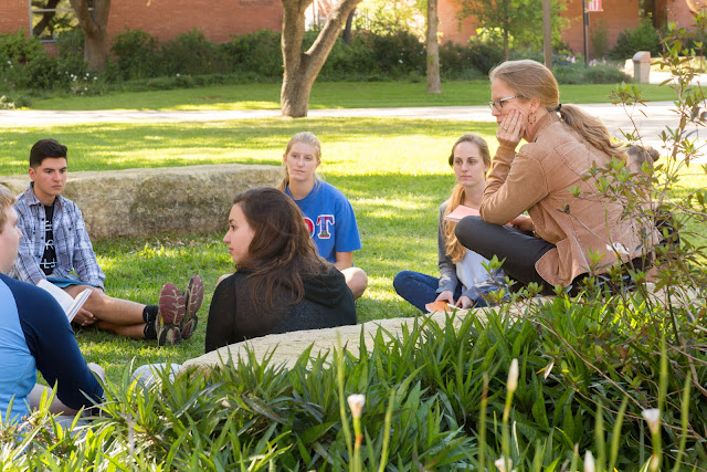 Trinity University English class outdoors