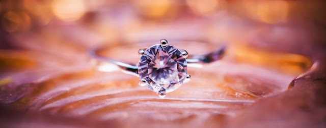Close up of a diamond ring.