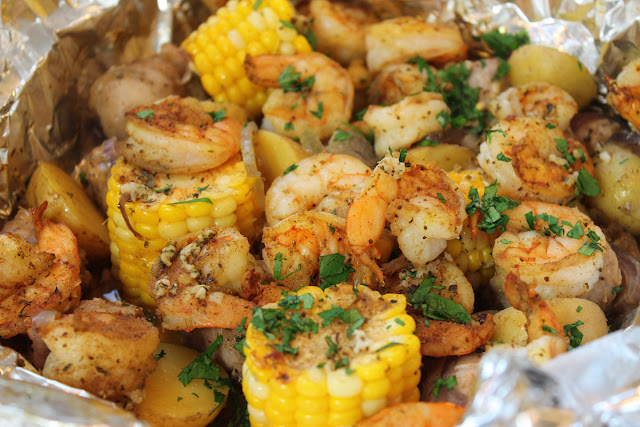 A shrimp boil dinner ready to eat.