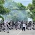 Enfrentamientos entre manifestantes de la UASD y policías frente al Palacio