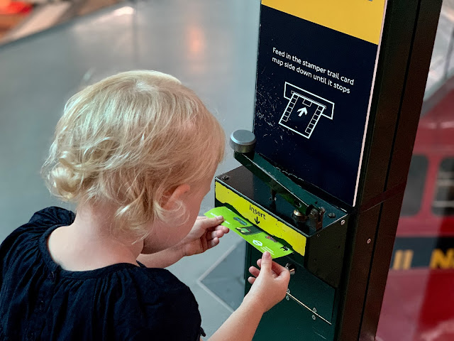 Stamping a trail card in london transport museum