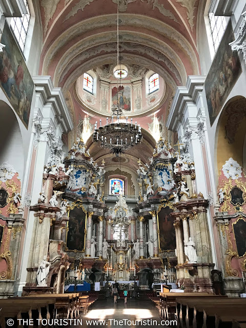 Ornate pastel ceiling and view towards the altar at the Dominican Church of the Holy Spirit in Vilnius in Lithuania