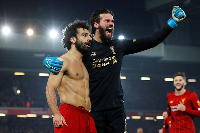 Mo Salah and Alisson celebrating