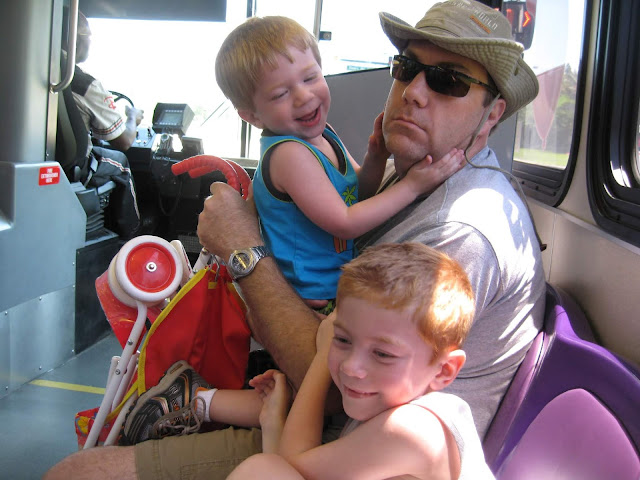 I photo of David Brodosi and his family on a bus at Disney
