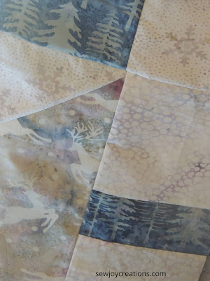 Prancing reindeer and blue evergreen tree fabrics