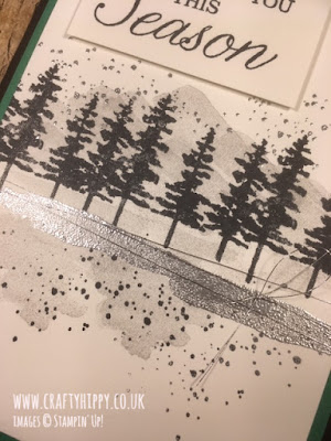 Handmade Christmas card showing a snowy monochromatic forest made using the non-festive Waterfront stamp set by Stampin' Up! in shades of black, green and silver