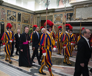US President Barack Obama on his way to an audience with Pope Francis in 2014, with a Swiss Guard escort