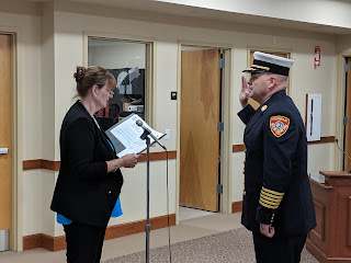 Town Clerk Teresa Burr swearing in new Franklin Fire Chief James G. McLaughlin