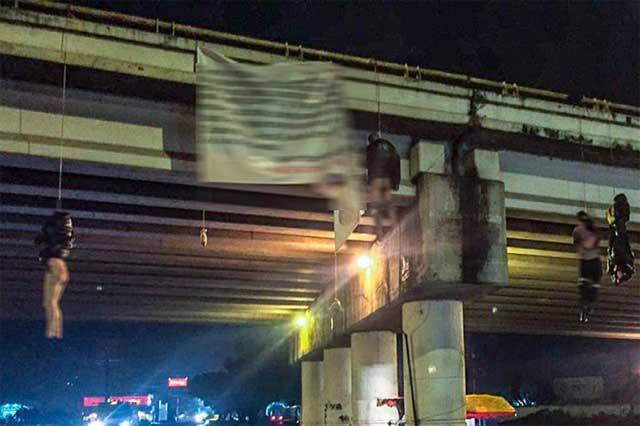 Menggantung Mayat di Bawah Jembatan Layang