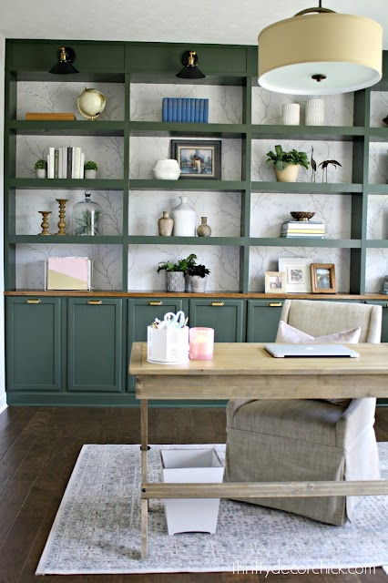 Green bookcases with wood counter brass hardware