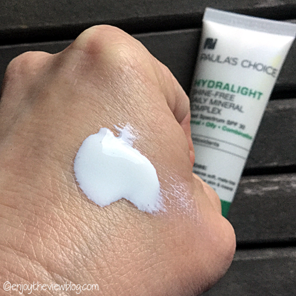Paula's Choice Hydralight Shine-Free Daily Mineral Complex sunscreen on the back of a hand