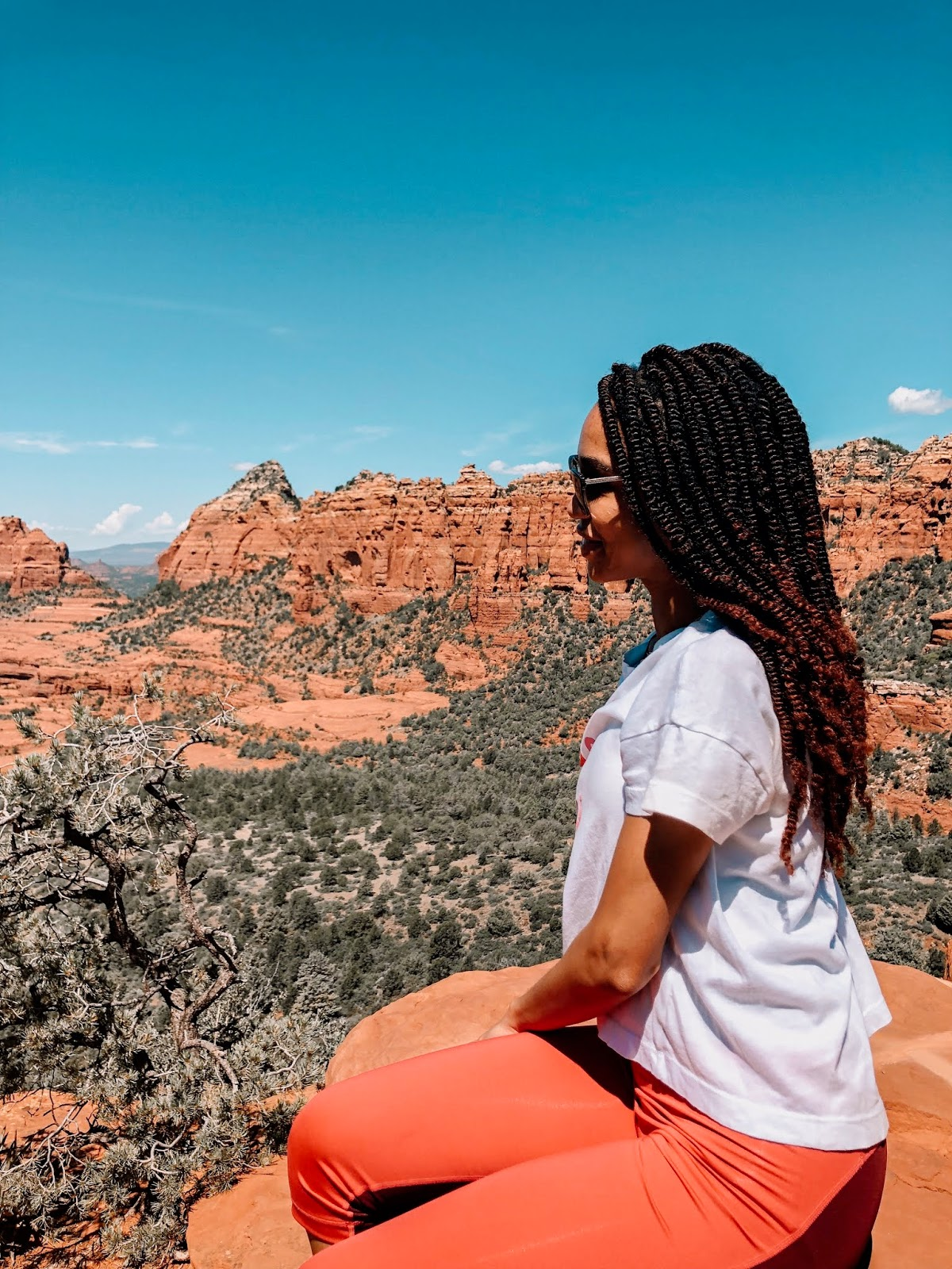 Sitting on the edge of the cliff with a scenic view of Sedona Arizona during a jeep tour