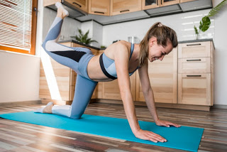 beautiful-woman-exercising-yoga-mat_23-2148539234
