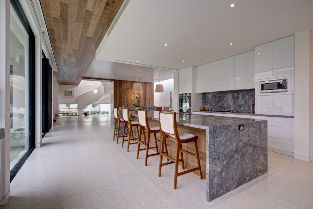wooden-panelled-grey-marble-kitchen