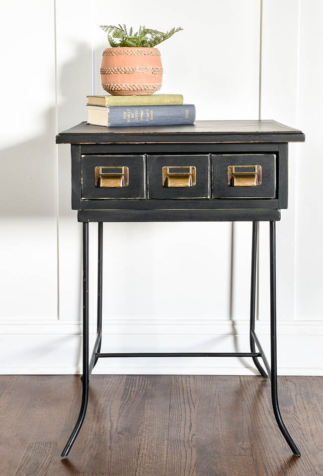 Black side table with metal labelholders