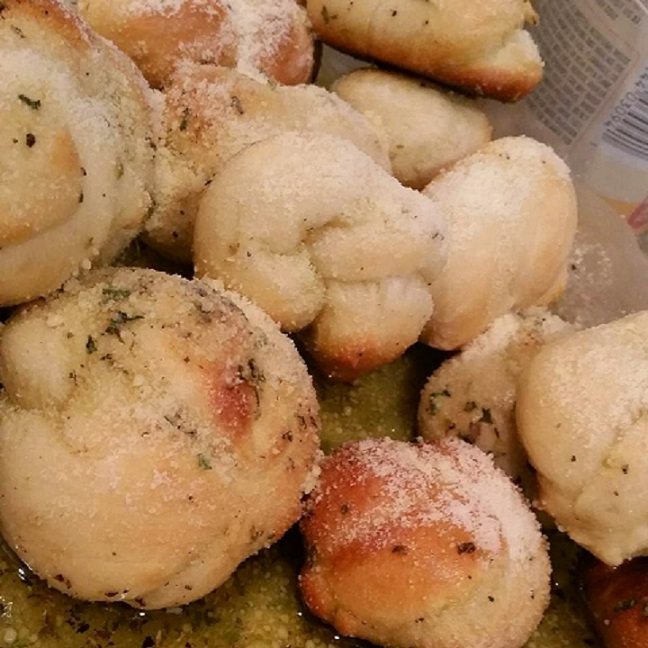 pizza dough knots coated with garlic and oil