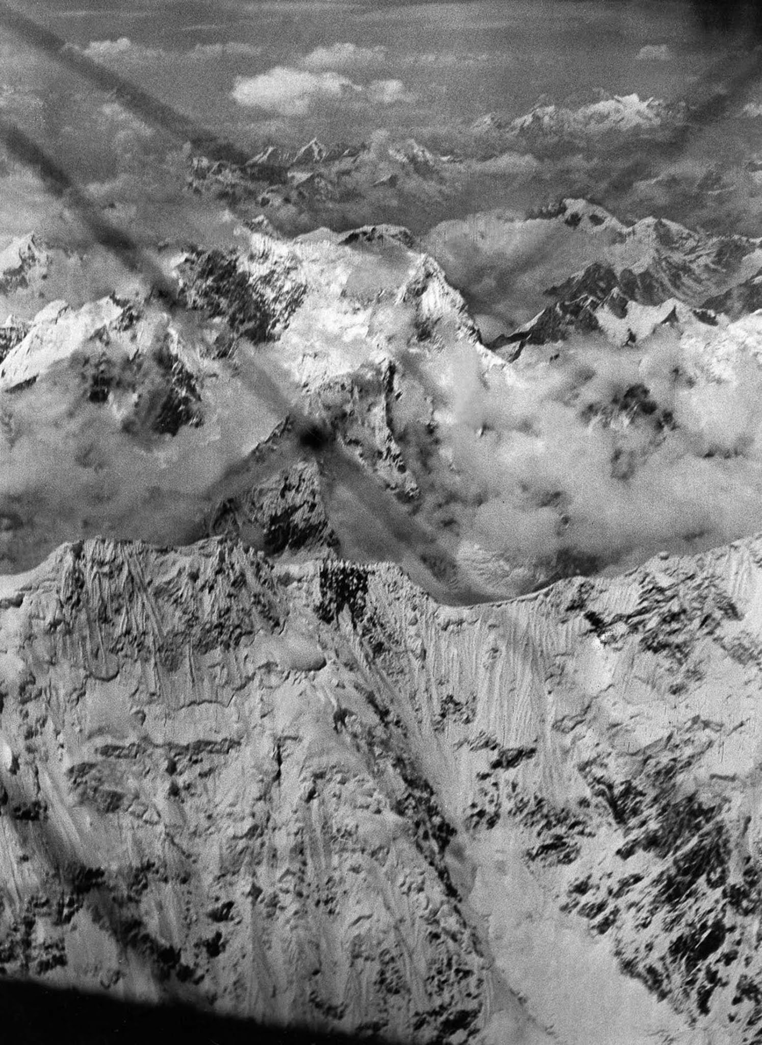 The expedition flies over Kanachenjunga, the third highest mountain in the world.