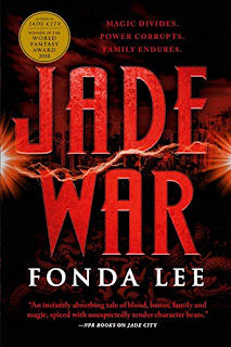 "Vibrant red lettering saying ""Jade War"" on a black and dark red background of carved jade. A red line of electricity runs across the middle of the book between ""Jade"" and ""War""."