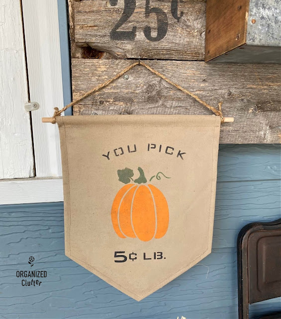 Photo of a painted and stenciled fall pumpkin banner/flag.