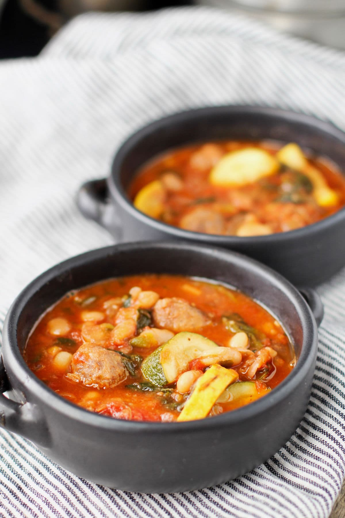 Sausage, Vegetable, and Bean Soup in bowls.