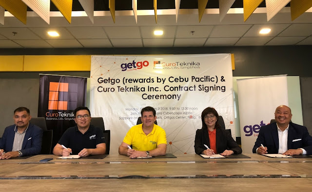 (L-R) JojoUligan, Former Chief Operating Officer of CuroTeknika, Inc.; Aaron Delapaz, Operations Manager Cebu Pacific Getgo Loyalty Rewards; Nik Laming, General Manager of Cebu Pacific's GetGo Lifestyle Rewards Program; Nerisse Ramos, Senior Vice President and Chief Operating Officer of ePLDT Group and President of CuroTeknika; and Jett Tinio, Current Chief Operating Officer of CuroTeknika grace the ceremonial contract signing for GetGo's adoption of Managed Contact Center services from CuroTeknika. CuroTeknika is an ePLDT subsidiary that offers Managed IT Services and Business Process Outsourcing to various industries in the country.