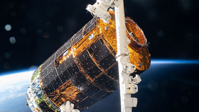 JAXA's (Japan Aerospace Exploration Agency) H-II Transfer Vehicle-9 (HTV-9) is pictured in the grips of the Canadarm2 robotic arm after its capture following a five-day trip to the International Space Station. The HTV-9 was carrying over four tons of food, supplies and experiments to replenish the Expedition 63 crew.