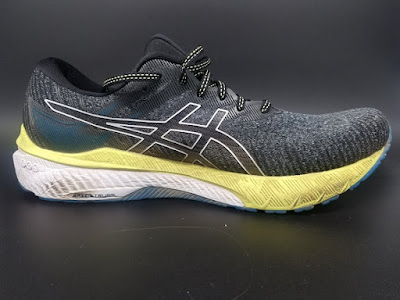"""Medial side of the Asics GT-2000 10. """"Lite Truss"""" system thinly seen at botom along heel to midfoot, with denser white foam surrounding it."""